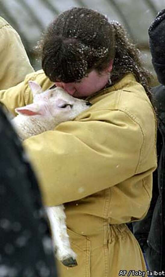 Linda Faillace kissed a lamb at her farm in East Warren, Vermont. Associated Press photo by Toby Talbot