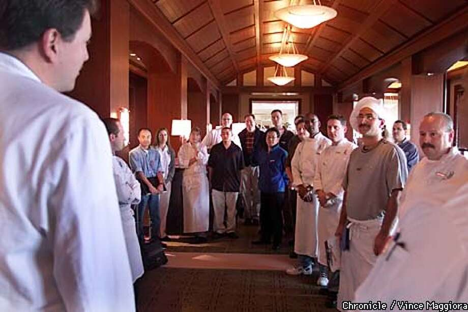 Bruno Lopez, far left, executive chef of the Half Moon Bay Ritz-Carlton, held a culinary pep rally on the first day of training for all chefs and cooks. Chronicle photo by Vince Maggiora