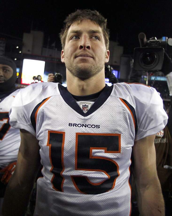 Denver Broncos quarterback Tim Tebow walks off the field following an NFL divisional playoff football game against the New England Patriots Saturday, Jan. 14, 2012, in Foxborough, Mass. The Patriots defeated the Broncos 45-10. (AP Photo/Charles Krupa) Photo: Charles Krupa, Associated Press