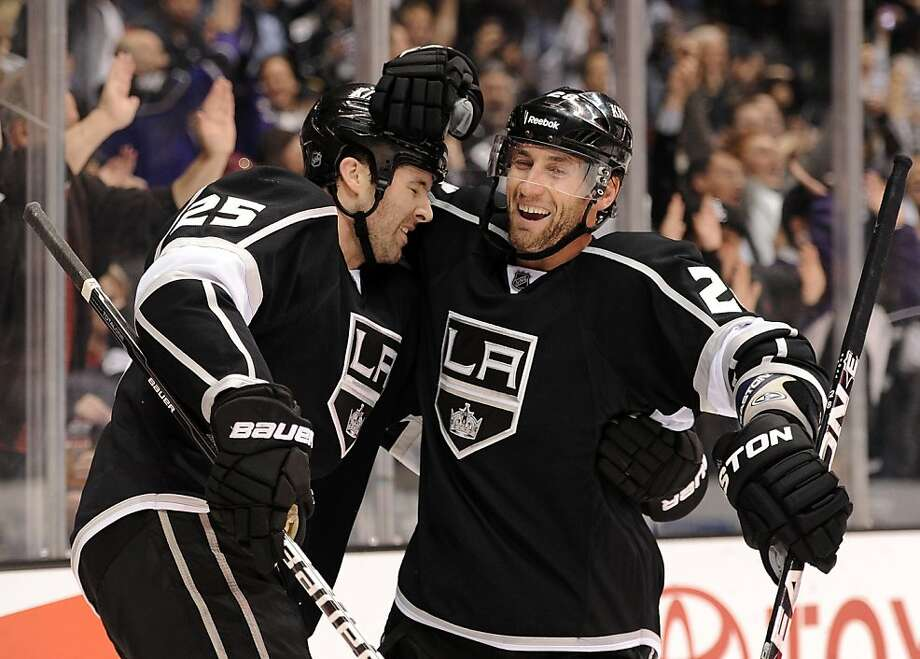 Dustin Penner #25 of the Los Angeles Kings celebrates his goal with Jarret Stoll #28 for a 2-1 lead over the Columbus Blue Jackets during the second period at Staples Center on February 1, 2012 in Los Angeles, California. Photo: Harry How, Getty Images