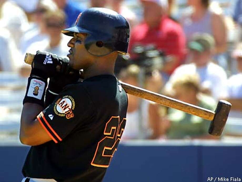 San Francisco Giants' Eric Davis stands in the on-deck circle with a sledgehammer during the third inning against the Anaheim Angels, Thursday, March 22, 2001, in Tempe, Ariz. The Angels won the spring training game 10-1. (AP Photo/Mike Fiala) Photo: MIKE FIALA
