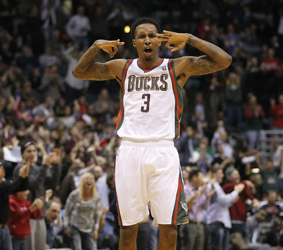 Milwaukee Bucks' Brandon Jennings reacts after his 3-point against the Miami Heat during the second half of an NBA basketball game Wednesday, Feb. 1, 2012, in Milwaukee. The Bucks won 105-97. (AP Photo/Jeffrey Phelps) Photo: Jeffrey Phelps, Associated Press