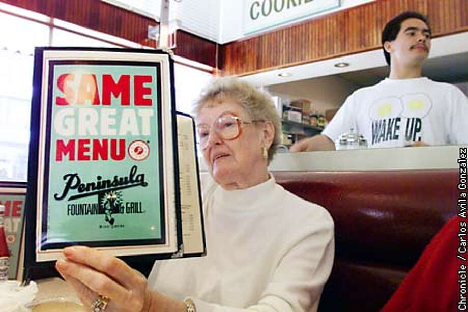 Bea Churma, of San Carlos, reads through the menu at the Peninsula Creamery in Palo Alto on Tuesday, February 2, 1999. The creamery has been at the same location since 1923. BY CARLOS GONZALEZ/THE CHRONICLE Photo: CARLOS GONZALEZ