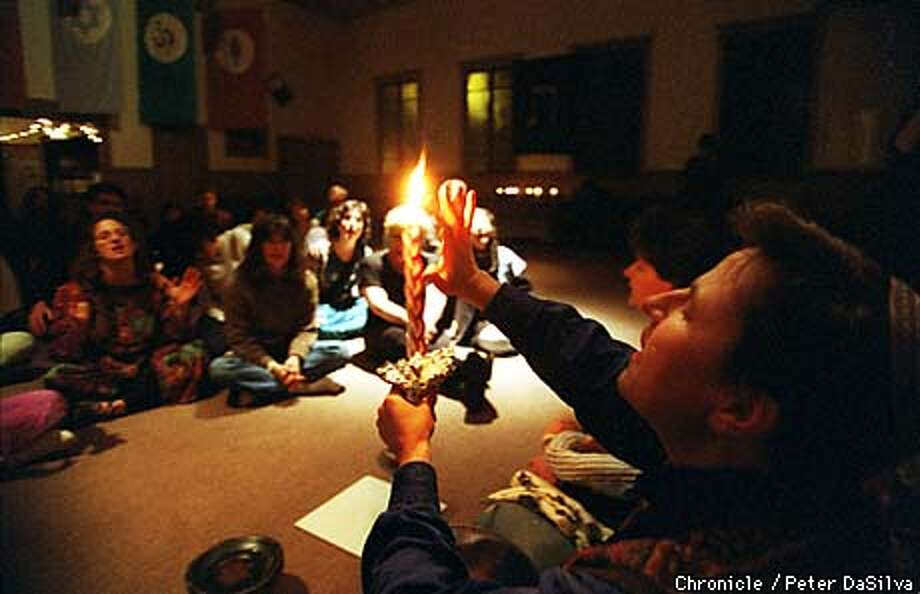 """Torahrave"" is a ""gently guided"" spontaneous movemnet experience that integrates community ritual, dance, brreathing,chant and meditation along with music. Gershon Steinberg-Caudill holds a candle at the beginning of the ceremony. Peter Dasilva/The Chronicle Photo: MICHAEL MACOR"