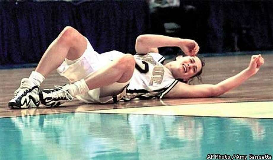 Stephanie White-McCarty laid on the floor with an injured ankle that forced her out of the game for the final four minutes. AP Photo by Amy Sancetta
