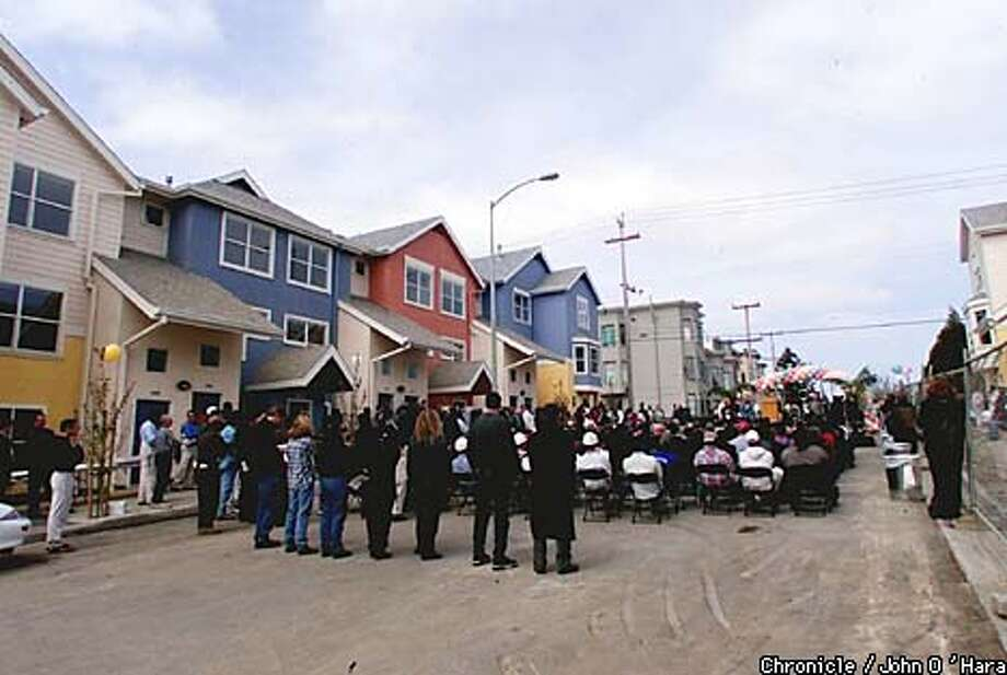 A crowd filled the street to listen to Mayor Brown and other dignitaries speak at the opening of the new Bernal Dwellings. Chronicle photo by John O'Hara