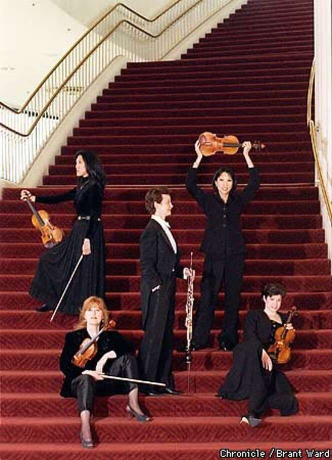 San Francisco Symphony women musicians and the black outfits they have to wear at work. Chronicle Photo by Brant Ward