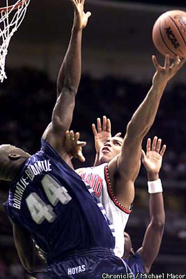 Maryland's 35- Lonny Baxter goes up for a shot against Georgetown's 44- Ruben Boumtje Boumtje in the first half. Georgetown V. Maryland third round action at the Anaheim Pond, Southern Califronia by Michael Macor/The Chronicle Photo: MICHAEL MACOR