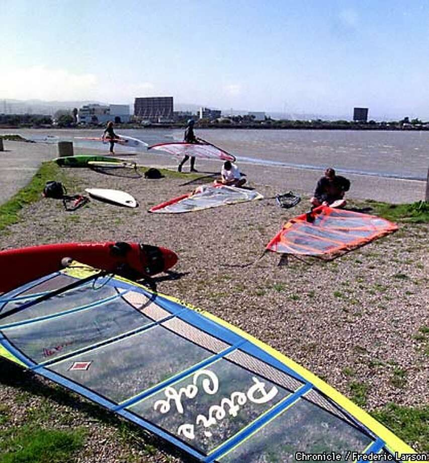 Windsurfers prepared their rigs before venturing out onto the water. Chronicle Photo by Frederic Larson