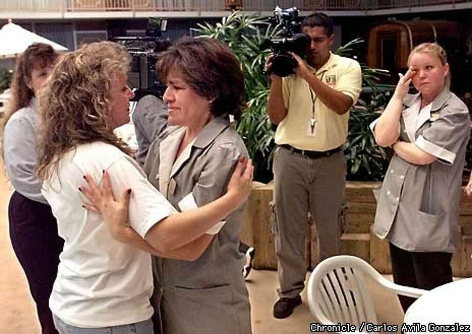 Raquel Pelosso (left) hugged Gladys Teves after the housecleaning crew of the Holiday Inn of Modesto donated their bonus checks to her to help defray the cost of her stay in Modesto the past month during the search for Pelosso's daughter Silvina and her friends, Carole and Julie Sund.  Chronicle Photo by Carlos Avila Gonzalez