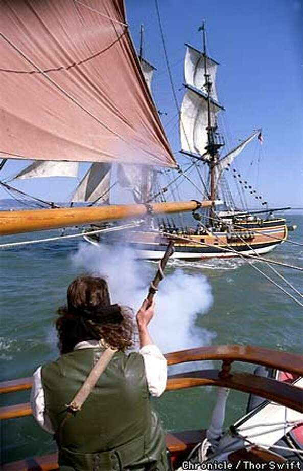 The Hawaiian Chieftan (left) fired upon the Lady Washington during the battle staged for A&E network. Chronicle Photo by Thor Swift