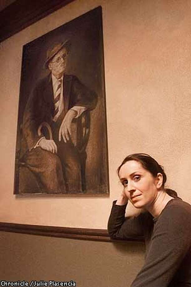 Irish Artist Ann Marie Ryan, whose art work of famous  Irish folks such at author James Joyce pictured here hangs in Beckett Pub in Berkeley just in time for St. Patrick's Day. (JULIE PLASENCIA/THE CHRONICLE) Photo: JULIE PLASENCIA