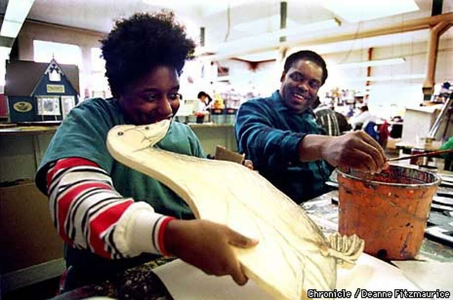 CREATIVE HANDS: Terri Bowden (left) of Union City and Larry Randolph of Oakland hone their artwork made of wood in a class at the Creative Growth Art Center in Oakland. Chronicle Photo by Deanne Fitzmaurice