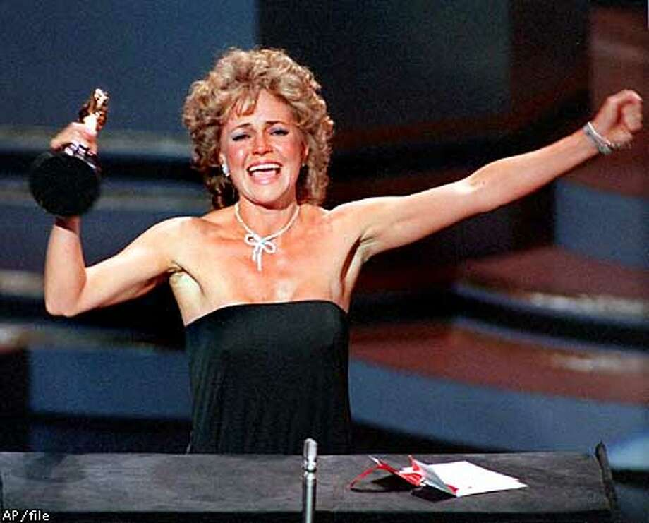 """Actress Sally Field accepts her Academy Award for best actress in the film """"Places in the Heart"""" at the Oscar ceremonies in Los Angeles March 26, 1985. """"I can't deny the fact you like me, """" she said in her acceptance speech, """"Right now, you like me."""" (AP Photo/Files)"""