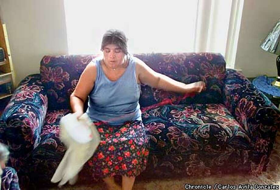 """Lorenza Remigio, a Mixtec indian from Oaxaca Mexico, sews a """"servilleta,"""" a serving cloth for tortillas in her home in Fresno, on Tuesday, March 20, 2001. Lorenza hopes that Mexican President Vicente Fox's visit will yeild reforms in immigration policy, and better conditions for field workers, many of which are here illegally. Her husband is a farmworker in a dairy outside of Fresno. (Photo by Carlos Avila Gonzalez/The San Francisco Chronicle) Photo: CARLOS AVILA GONZALEZ"""