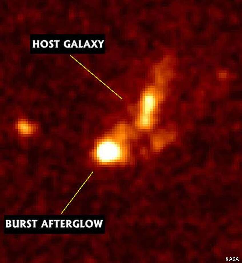 An undated image downloaded from the internet taken by the Hubble Space Telescope shows the afterglow and the host galaxy of an extraordinarily bright cosmic gamma-ray flash, discovered by the BeppoSAX satellite on Jan. 23, 1999. The gamma-ray burst, called GRB 990123, turns out to be the most energetic one measured so far, according to a team of astronomers from the California Institute of Technology. (AP Photo/Caltech GRB Team, Space Telescope Science Institute)