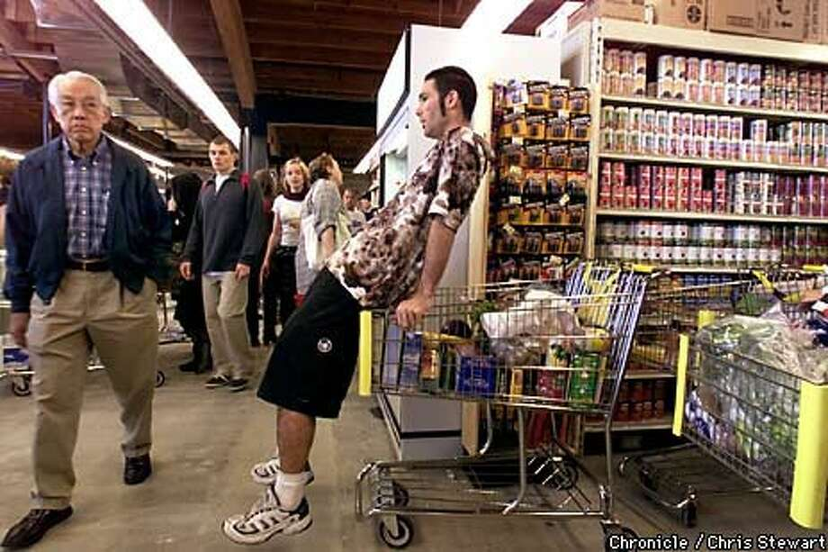 Mario Nimnicht, 25, patiently waited in a long checkout line on opening day of the Berkeley Bowl at its new site. Chronicle Photo by Chris Stewart