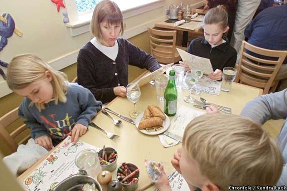 As Kate Kimball, 8, colors mom Julie Kimball and Lauren Kimball, 12, looks at their menus at Yankee Pier in Larkspur also at the table are Steve Kimball and Carter Kimball, 6. (KENDRA LUCK/SAN FRANCISCO CHRONICLE) Photo: KENDRA LUCK