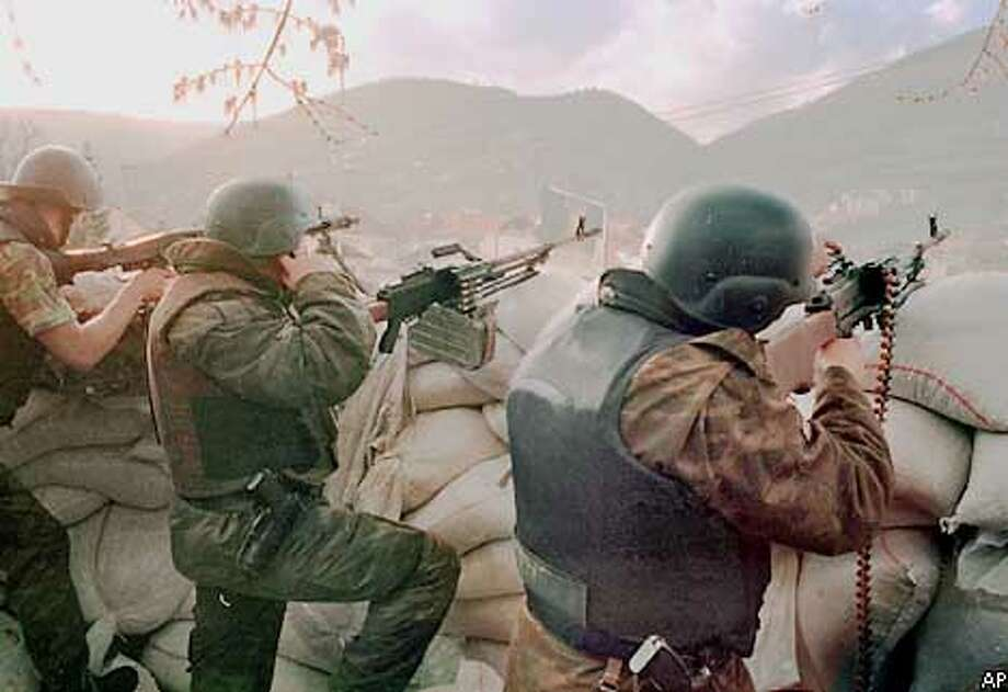 Macedonian forces fire on suspected ethnic Albanian rebels positions in Tetovo, Macedonia, Tuesday March 20, 2001. (AP Photo/str)