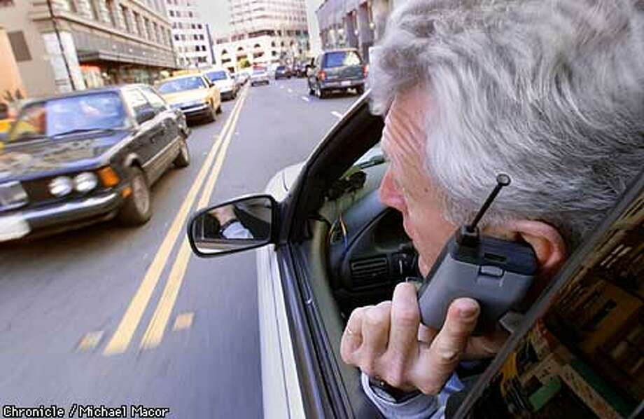 The dangers of driving while using a cell phone. *********PHOTO ILLUSTRATION********* Michael Macor/The Chronicle Photo: MICHAEL MACOR