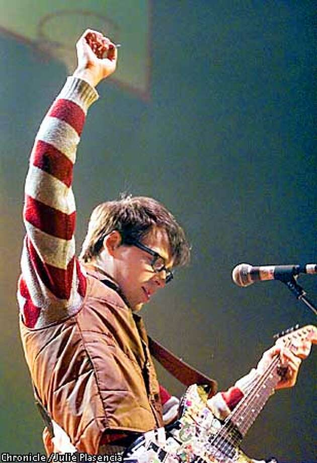 Lead singer Rivers Cuomo of the perennial cult favorite band WEEZER plays at the Bill Graham Civic Auditorium in San Francisco on Saturday, March 17, 2001. The band is touring for internet giant YAHOO's multi-media festival. (JULIE PLASENCIA/THE CHRONICLE) Photo: JULIE PLASENCIA