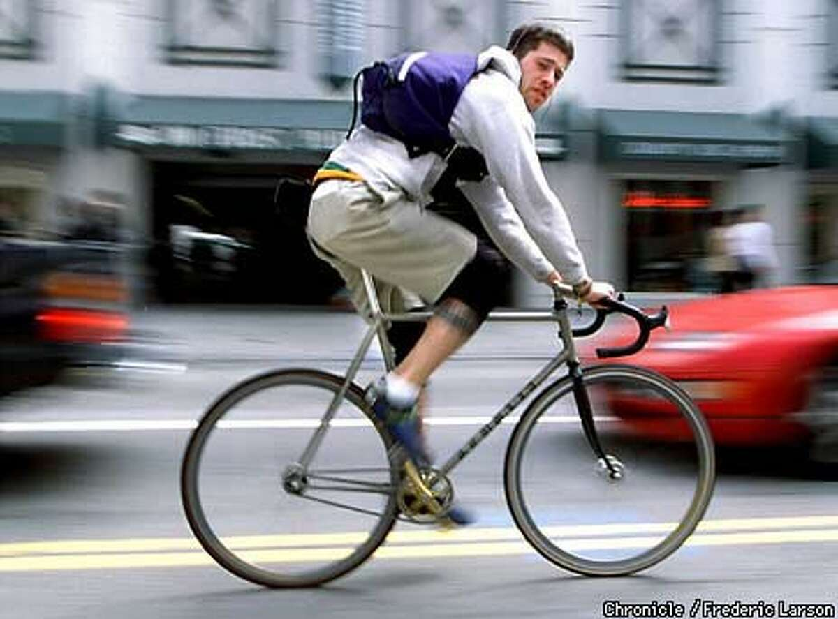 Messenger Chris Scuglia, 28, rode through S.F. on an extra-fast track bike, which can cut a run's time in half. Chronicle Photo by Frederic Larson