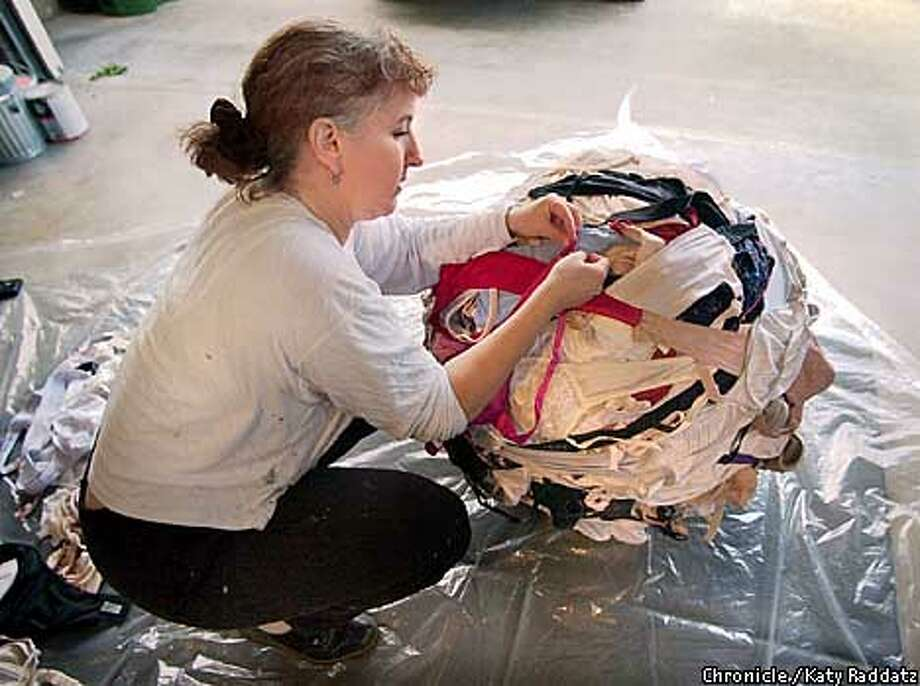 EBBRA16a-C-09MAR01-EF-RAD  Photo by katy Raddatz--The Chronicle  Emily Duffy is building a gigantic ball of bras--it's called the BraBall Sculpture, to be unveiled at ProArts. (1737 Ganges Ave. el Cerrito 94530 510-234-5924). Photo: KATY RADDATZ
