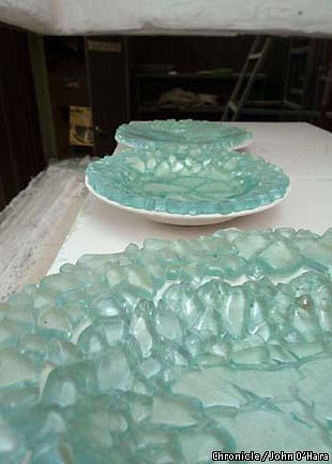 Trashy crafts artists transform broken muni glass into for Broken glass crafts