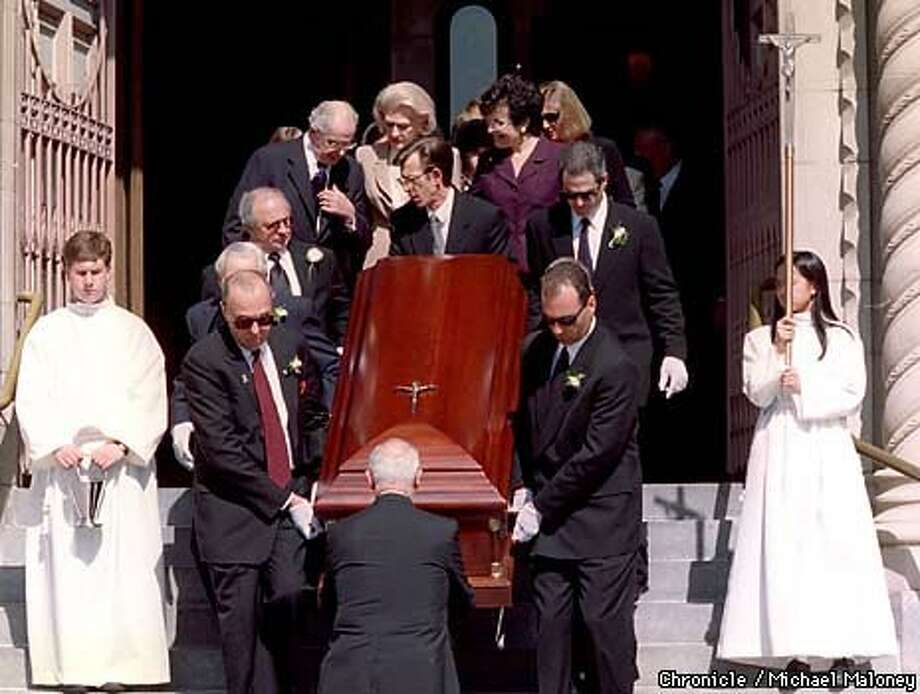 Joe DiMaggio's casket was carried down the steps of SS Peter and Paul's Church in North Beach after the funeral Mass. Chronicle Photo by Michael Maloney