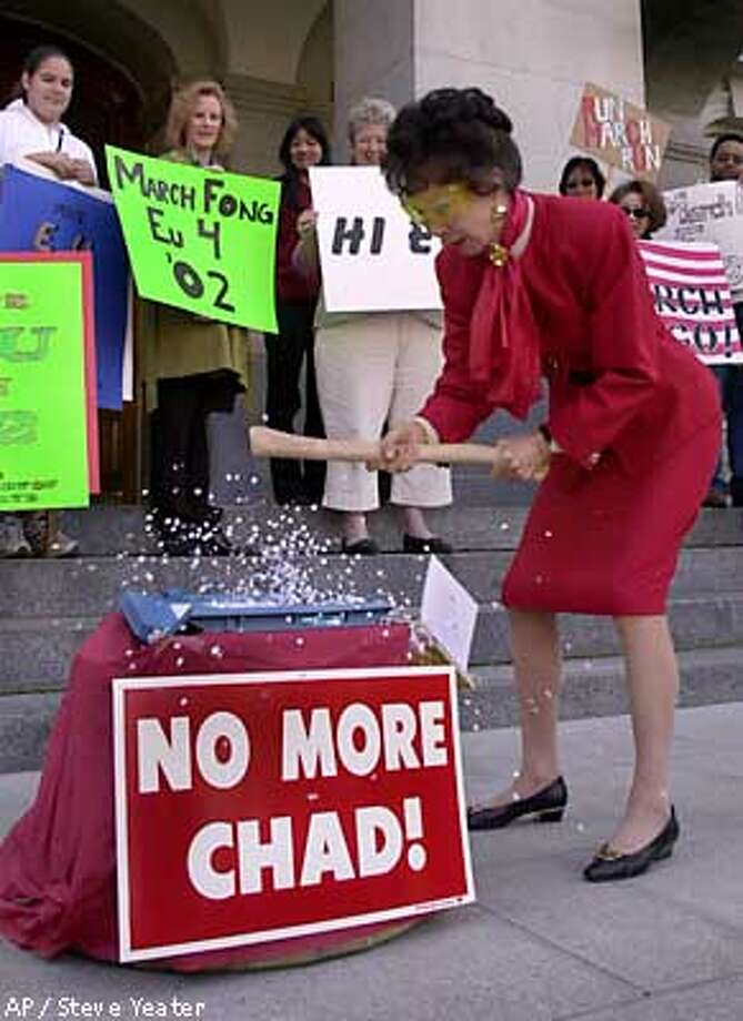Former California Secretary of State smashes a punchcard voting machine during a news conference to announce that she will run for again for the office in 2002, in Sacramento, Calif., Tuesday, March 13, 2001. (AP Photo/Steve Yeater) Photo: STEVE YEATER