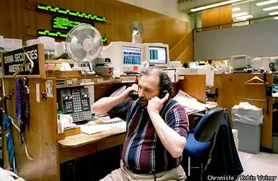 Independent floor broker Frank Gallagher worked the phones at the exchange. Chronicle Photo by Robin Weiner