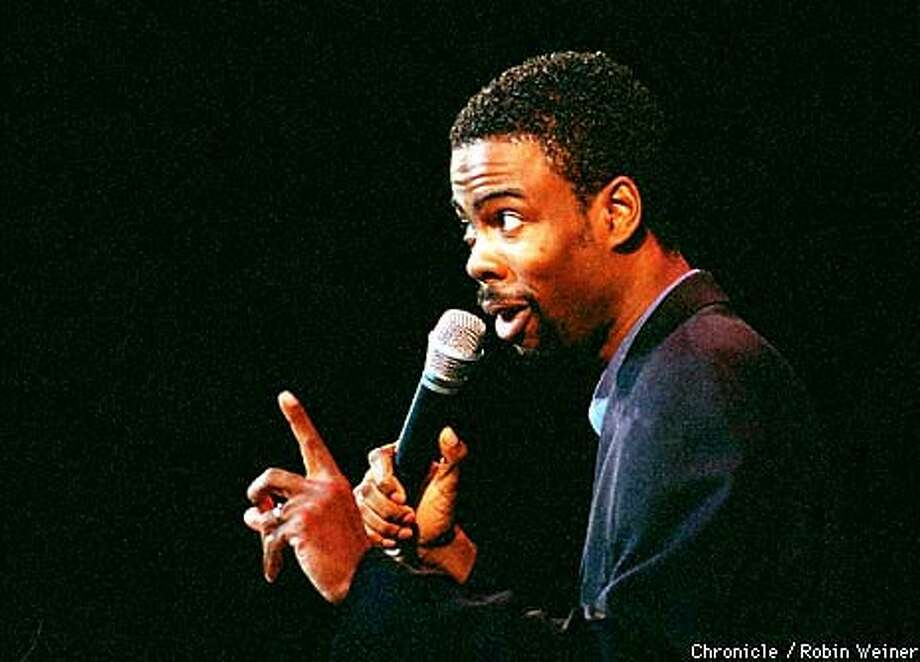 Chris Rock took on race relations, sex, taxes and Hillary Rodham Clinton at Oakland's Paramount Theatre. Chronicle Photo by Robin Weiner
