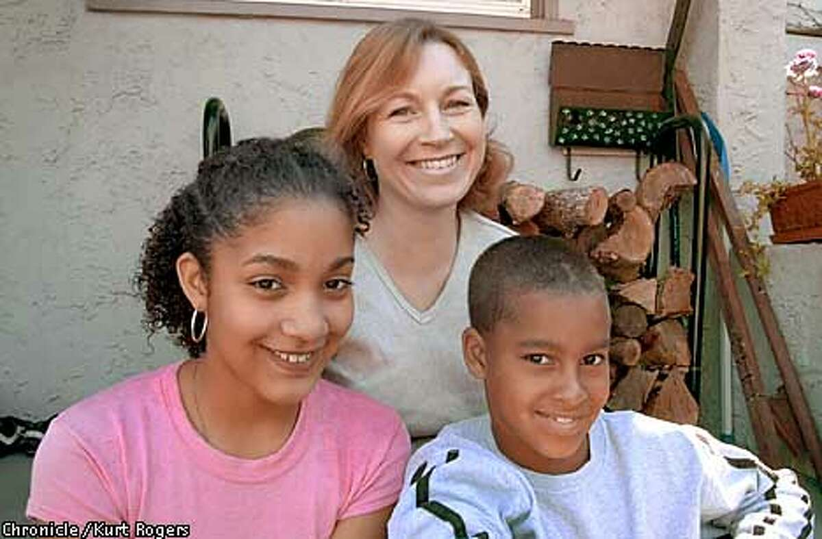 Stacey Bell and her children Vanessa and Nico at there home in Berkeley .Stacey is part of a Berkeley organization called I-Pride that has been working for recognition of multiracial backgrounds .Photo By Kurt Rogers
