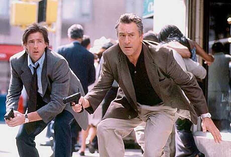 "Actors Edward Burns (L) and Robert De Niro (R) are pictured in an undated publcity photo from New Line Cinema's action thriller ""15 Minutes,"" opening in U.S. theaters March 9, 2001. The film follows two New York City homicide detectives (Burns and De Niro) as they track down a pair of Eastern European killers on a rampage across the city. REUTERS/Phillip Caruso/New Line Cinema-Handout Photo: HO"