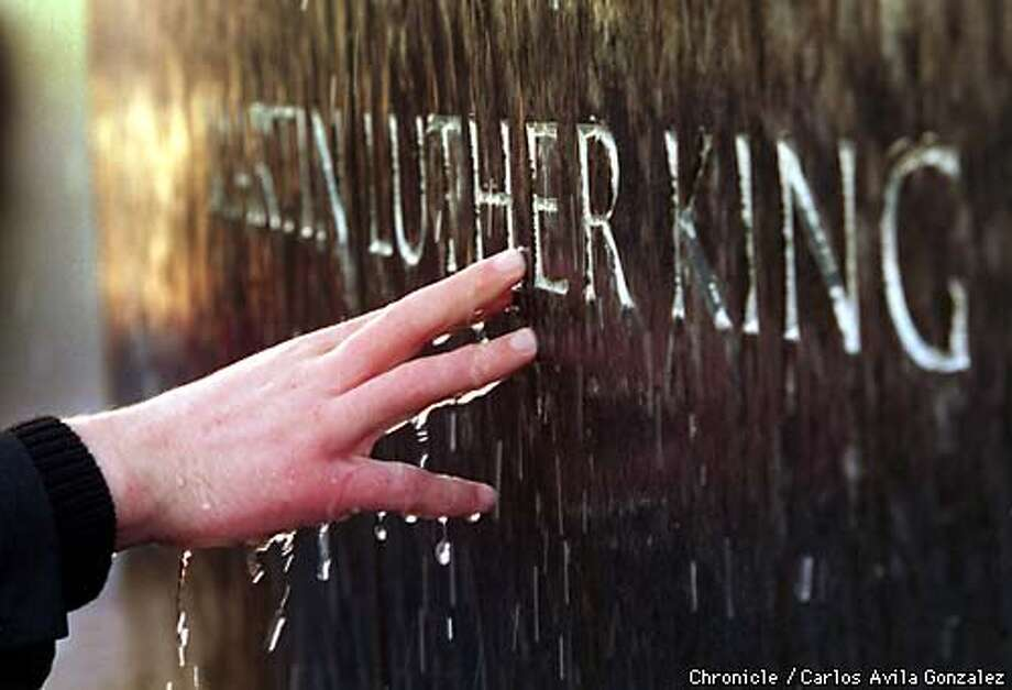At the Civil Rights Memorial, a student from Capuchino High School, touches the carved name of the Rev. Dr. Martin Luther King, Jr.  BY CARLOS GONZALEZ/THE CHRONICLE Photo: CARLOS GONZALEZ