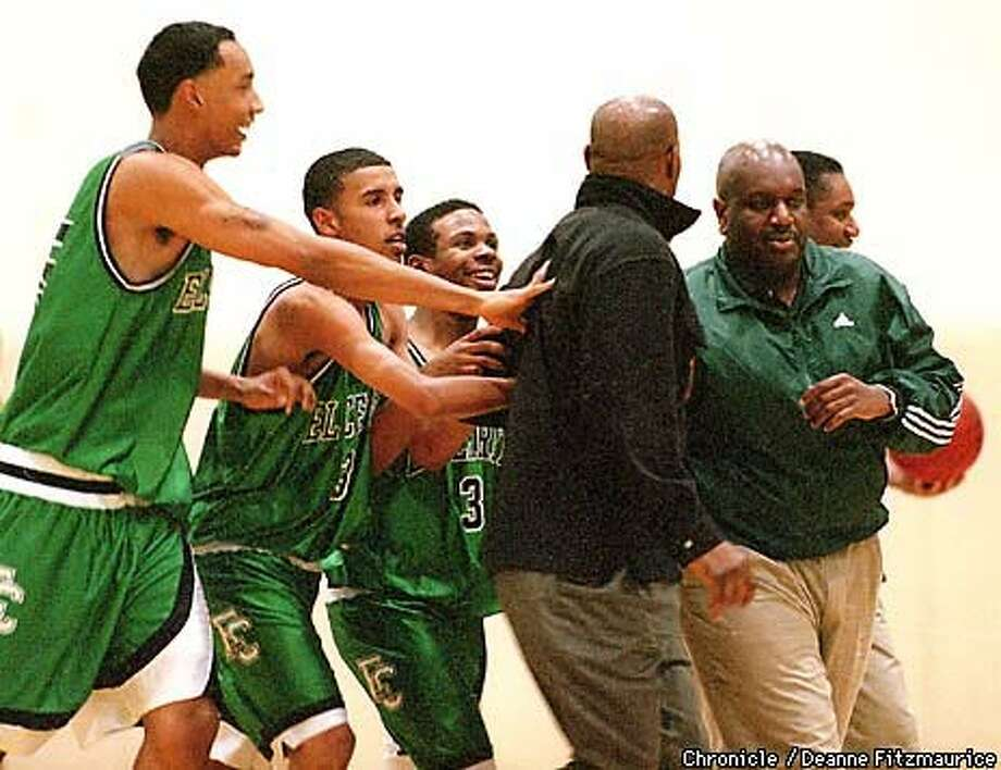 Andrew Gooden (far left) and his El Cerrito High teammates had to restrain his father after the elder Gooden (with back to camera) charged a ref last Friday night at Alameda High. Chronicle Photo by Deanne Fitzmaurice
