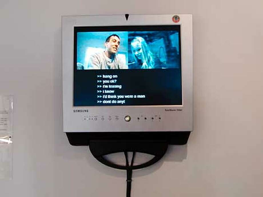 caption Tina LaPorta Re:mote_corp@REALities (telematic remix), 2001 from Telematic Connections: The Virtual Embrace San Francisco Art Institute February 7 - March 25, 2001