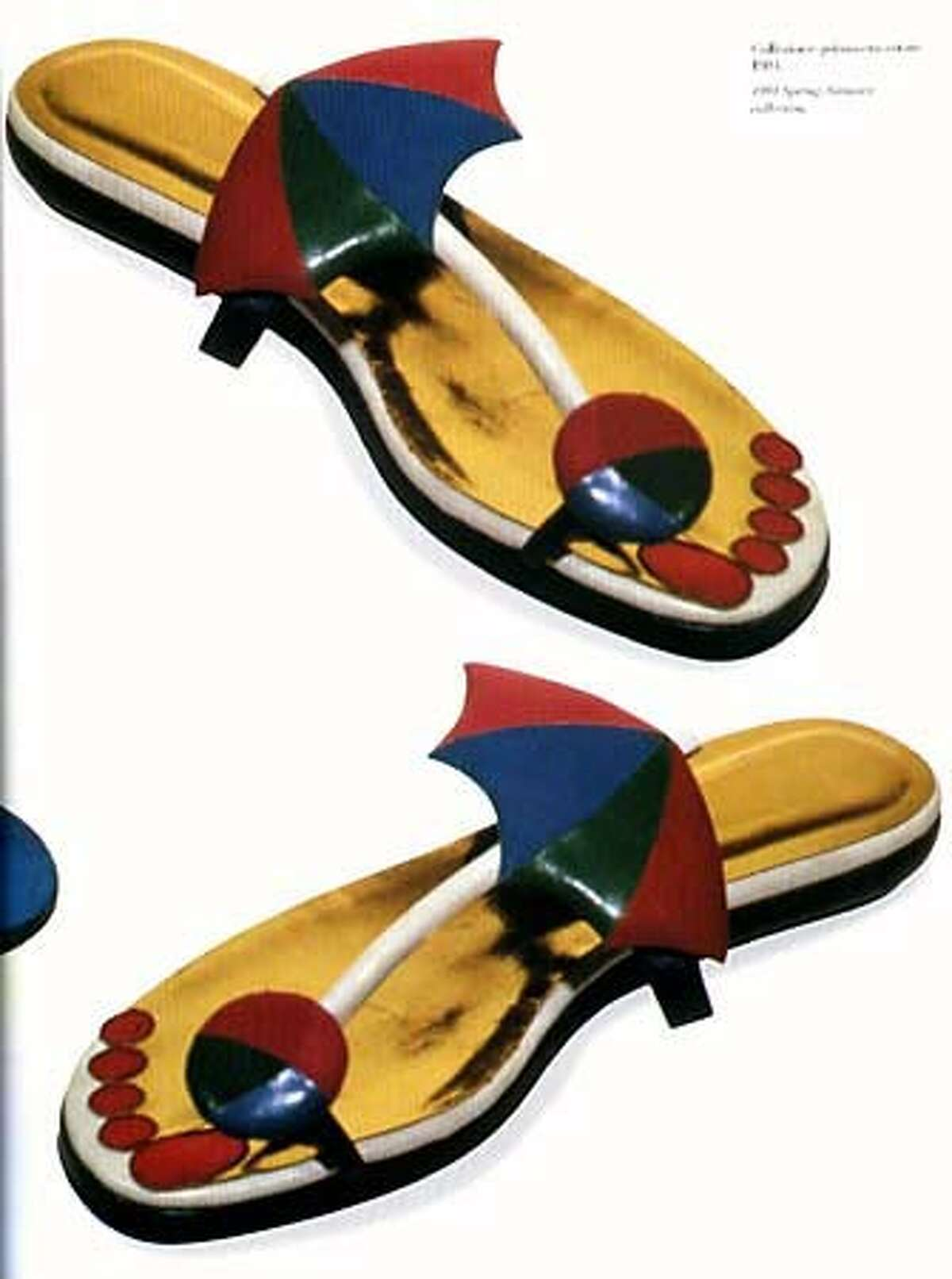 Pfister's beach-umbrella sandals with trompe l'oeil red toenails were part of his spring-summer collection in 1984