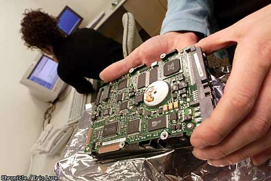 Kris Hayworth,manager, computer foresnic lab at Deloitte and Touche, packs up a computer hardrive that is used to mirror another computer's harddrive which takes twenty minutes once they have the suspect hardrive removed.  BY ERIC LUSE/THE CHRONICLE Photo: ERIC LUSE