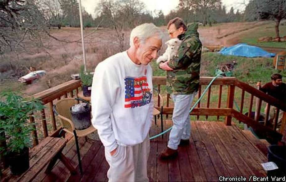 Dennis Peron (left) and friend Wayne Justmann on the deck of their Lake County farm. Chronicle Photo by Brant Ward