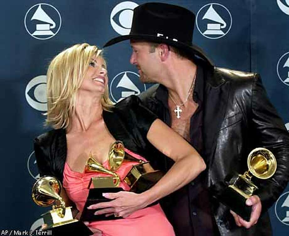 Husband and wife country stars Faith Hill and Tim McGraw showed off their awards. Associated Press photo by Mark J. Terrill