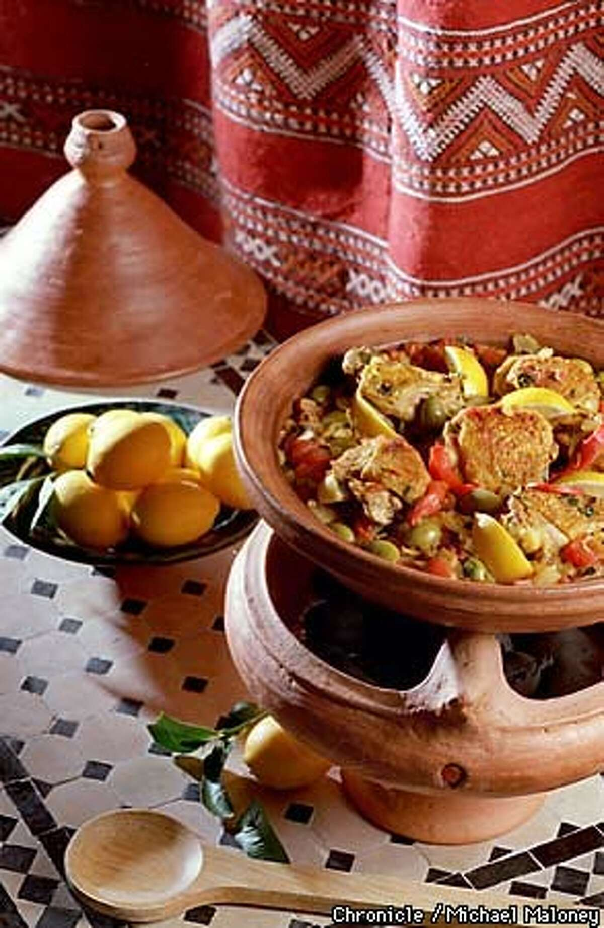 Cinnamon, ginger and cardamom lend exotic flavor and fragrance to a tagine of lamb meatballs in tomato-pea sauce. Chronicle Photo by Michael Maloney