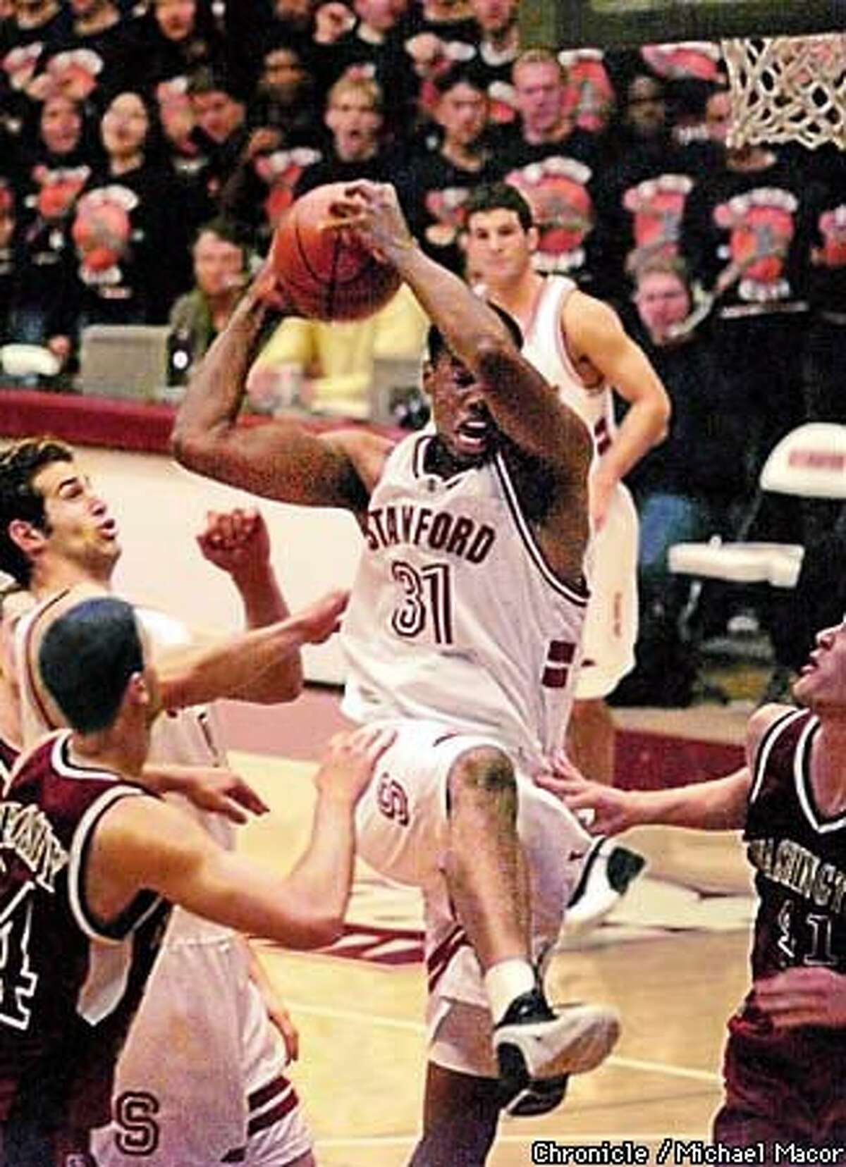 Jarron Collins pulled down a rebound in front of WSU's Chris Crosby (left) and Steve Slotemaker last night at Maples Pavilion.