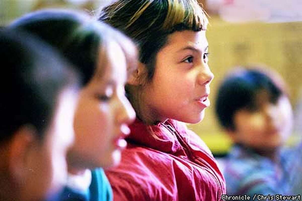 Jessica Bernal, 9, makes a point as she and other fourth and fifth graders at Cesar Chavez Elementary School join a meeting of the Philosophers Club. Chronicle Photo by Chris Stewart