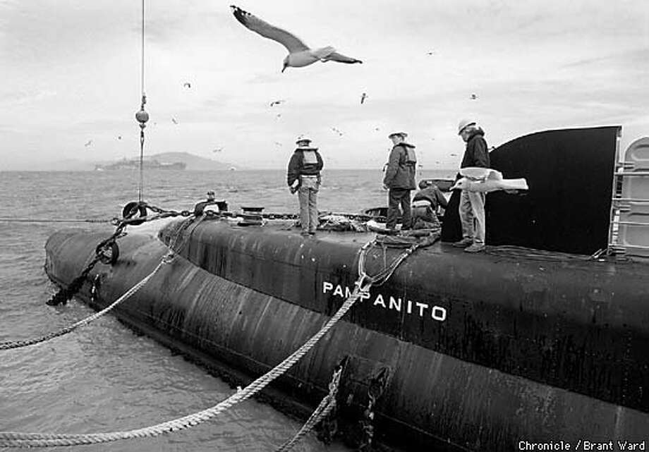 SUB3/04JAN99/SC/BW--Last minute preparations to move the Pamapanito to Alameda attracted a horde of gulls. By Brant Ward/Chronicle Photo: BRANT WARD