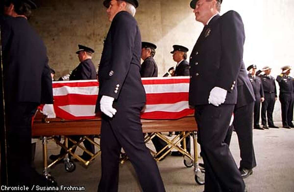 Firefighters saluted as the flag-draped casket was taken into the Coliseum arena. Chronicle Photo by Susanna Frohamn