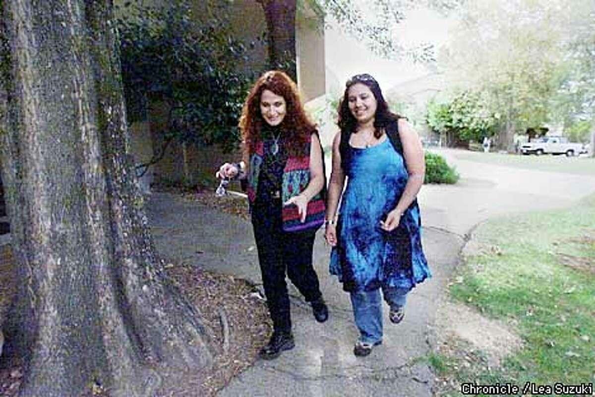 From left: Marina Tafuri and her daughter Daphne Sarran. Tafuri and Sarran walk across UC Santa Cruz campus to their home during the school day. Tafuri left Children of God cult. Photo By Lea Suzuki
