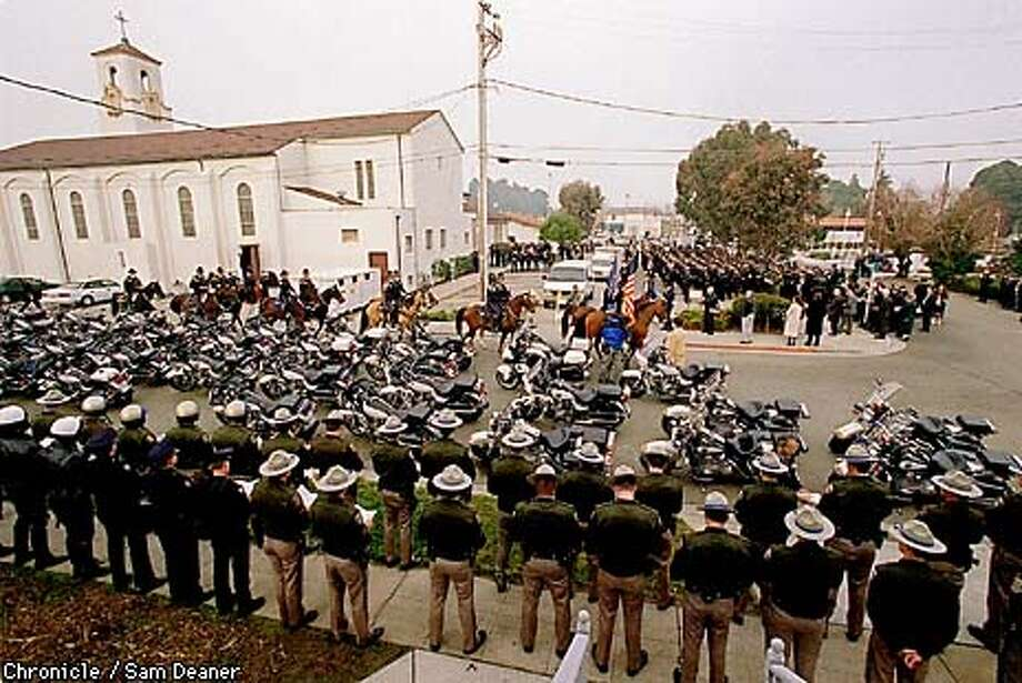 Roughly 700 police officers from around the state of California (as far south as San Diego) stand tall at attention as funeral services for slain Oakland Police Officer James Williams, Jr. get underway at St. Joseph's Catholic Church Thursday in Pinole. (CHRONICLE PHOTO/SAM DEANER) Photo: SAM DEANER