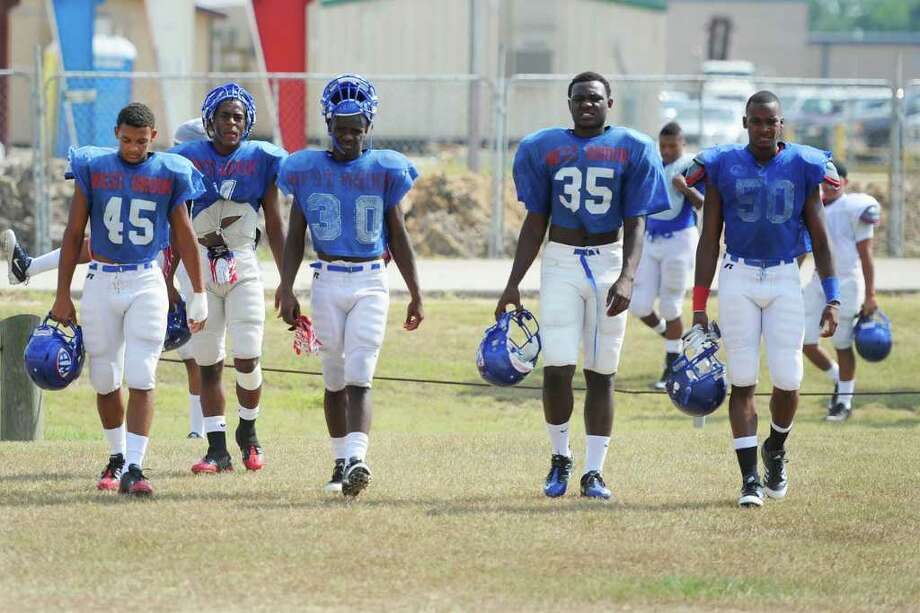 West Brook football players prepare to take the practice field on Tuesday. August 23, 2011.  Valentino Mauricio/The Enterprise Photo: Valentino Mauricio