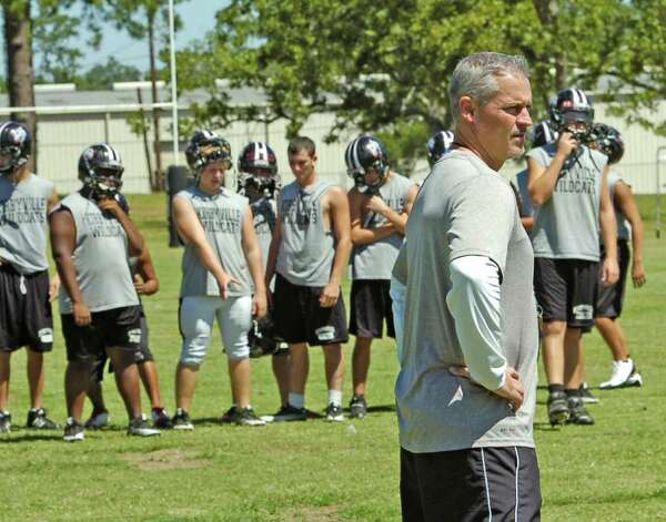 Kirbyville High School head football coach Greg Neece, center,watches for all his players to arrive for some practice Tuesday morning.  Neece will coach his team against Vidor's Jeff Mathews on Friday night. Mathews and Neece worked together in 2000 at Vidor High School and have remained friends ever since.      Dave Ryan/The Enterprise Photo: Dave Ryan